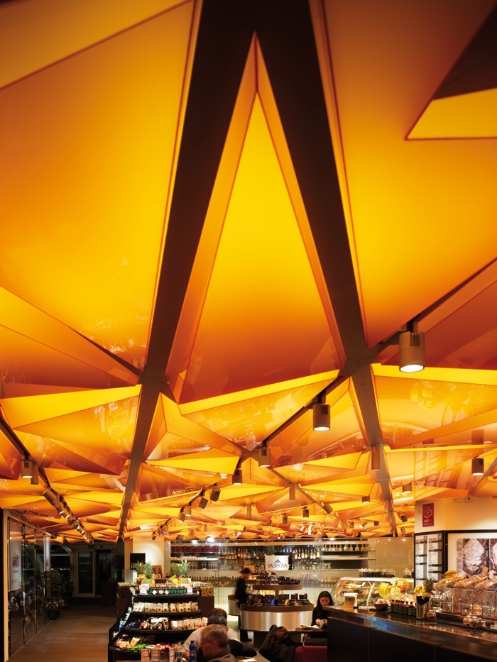 Lifschutz Davison Sandilands was inspired by honeycombs to create the stunning three-dimensional, backlit ceiling in the food hall of La Rinascente in Milan