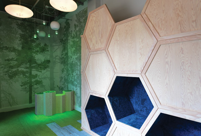 Playful hexagonal cubicles off er spaces for children to relax in