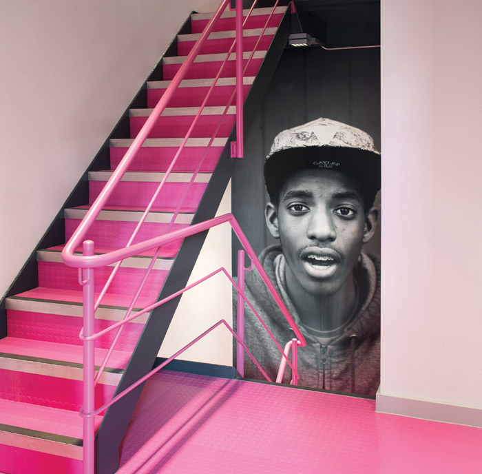 A hot-pink studded rubber floor from Kimpton echoes the colour of the charity's logo