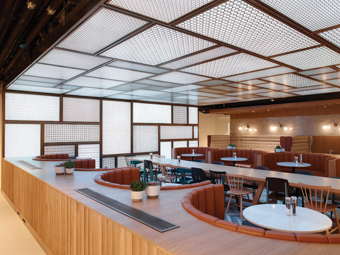 The lower-ground staff cafe features a ceiling lighting system that compensates for the lack of natural light in the space