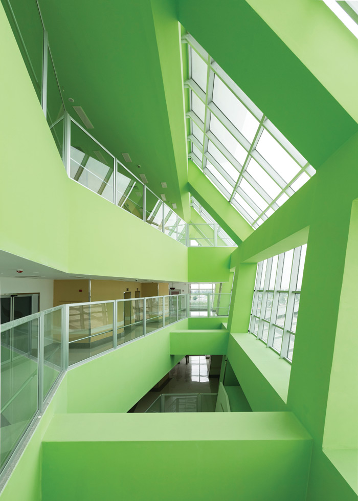 The 160-bed Pars hospital in Rasht, Iran, was designed by Lida Almassian and Shahin Heidari of Tehran-based New Wave Architecture. The 30,000 sq m private hospital features a colourful, open atrium to make wayfinding less stressful and has natural light and splashes of foliage throughout, reflecting the universal appeal of biophilia. Image Credit: Parham Taghioff