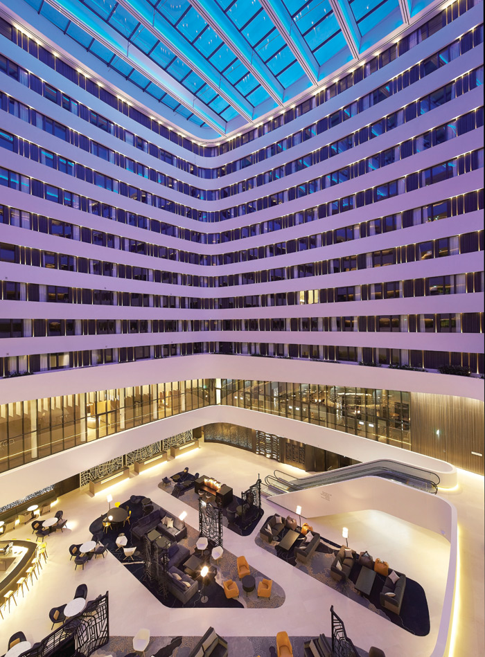The Hilton Hotel Schiphol shows how lighting can paint a space and ramp up the drama