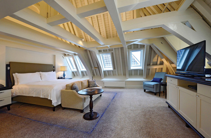 At the Waldorf Astoria in Amsterdam, staircase and guest room (far left) lighting responds to a whole gamut of design styles, from classical to cutting-edge contemporary