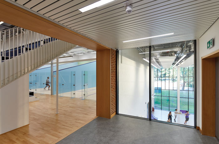 Sports spaces flow from one to the other: here, squash courts sit next to a high-ceilinged activity space