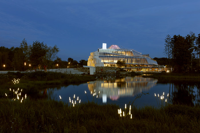 A view to the main building, from across the lake at night