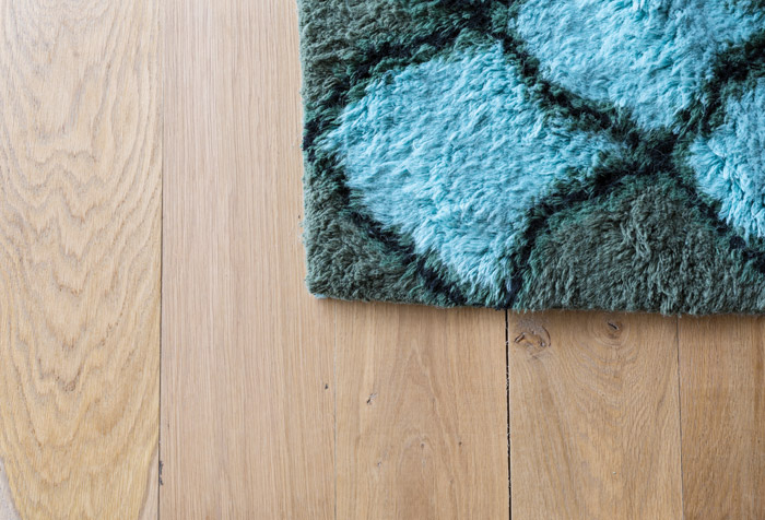 A bespoke rug sits on new French oak boards