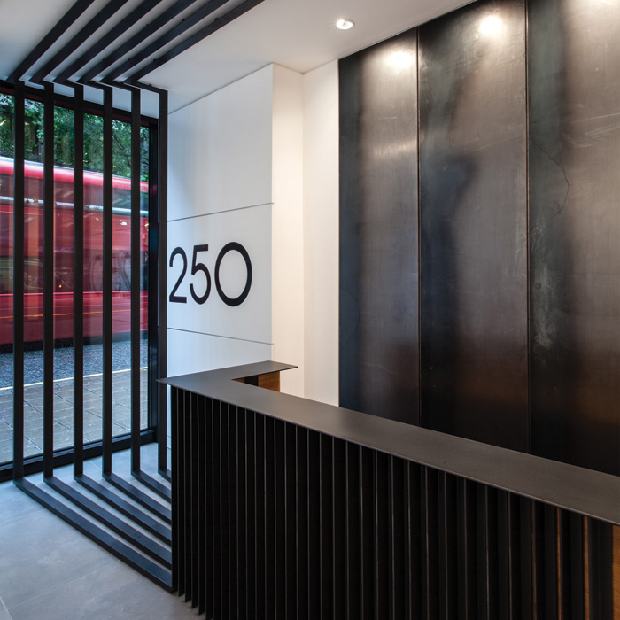 250 tottenham Court road, London: This saw the conversion of a retail building into office space, now fully let to tech and media companies. Karthaus and McDowell explain: 'We created a bespoke steel and timber structure ... wrapping around a double-height space to form a continuous and dramatic artwork for the building's entrance.'