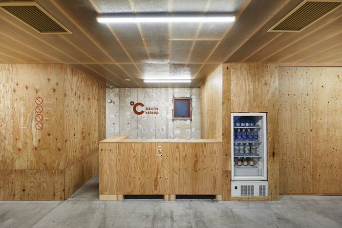 Finishes at the capsule hotel are minimal, such as with the sauna area