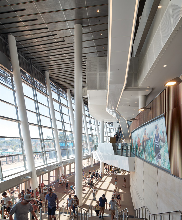 The soaring roof sits on pillars in the stadium's airy outer lobby