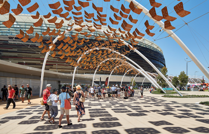The covered Community Arbour walkway, representing stories of the region's Noongar Community, links the six-platform Stadium Station to the Swan River