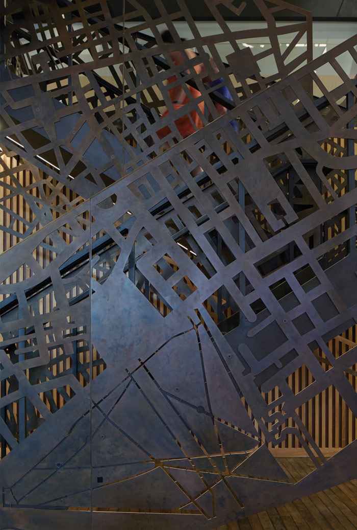 The staircase, carved into a map of London, is the centrepiece of Havas' reception area