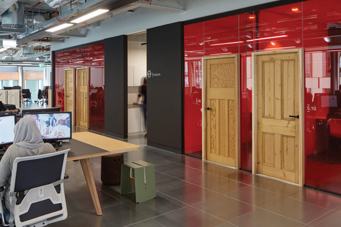 An eclectic collection of timber doors is a feature in one of the workspaces