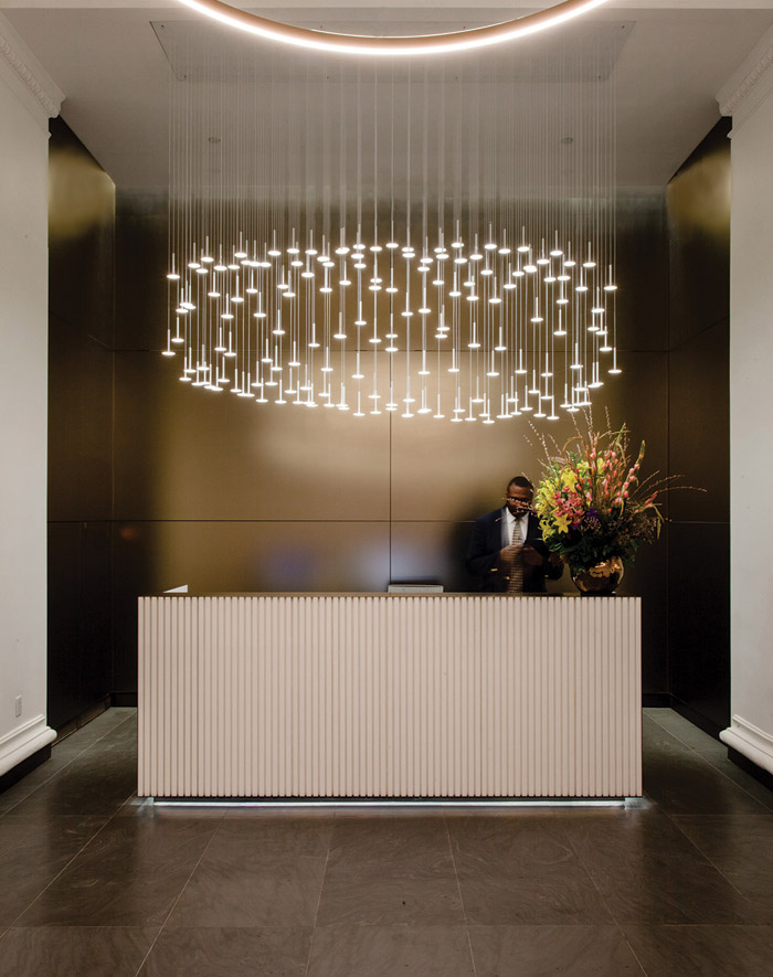 A custom-made cascading OLED installation positioned above the reception desk comprises 162 8cm-diameter circulat OLEDs. Photo Credit: Naomi Castillo Photography