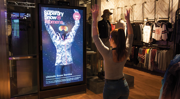 Seymour Powell's Smarter Mirrors, in use at Superdry in Berlin, use virtual reality to allow customers to 'try on' clothes without having to undress