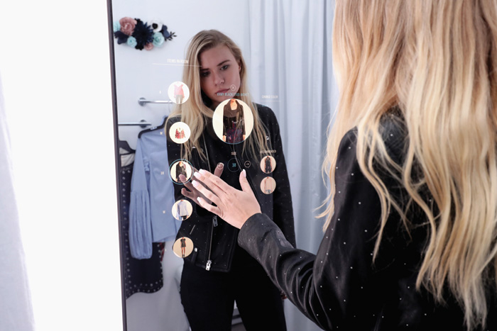 Smart mirrors from Oak Labs allow customers to control the fitting room environment through lighting, alerting sales staff when they need help, changing the language, and even paying for their items using the mirror itself