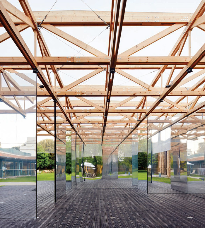 The new Pavilion at the Picture Gallery, Dulwich Village has been made highly flexible by IF_DO, with a timber truss roof suspended over a deck and supported on three mirrored panels. The other panels are moveable