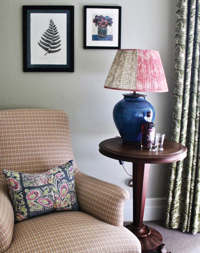 The Garden House: Pictured is a vintage silk saree lampshade and cushion by Samarkand Design for Nicola Harding Interior Design, as seen in The Garden House, Beaverbrook Hotel. The designs complement the hotel's lovely garden.