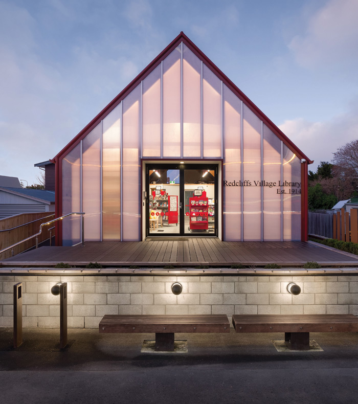 Small but perfectly formed, the tiny Redcliffs Library is run by volunteers from the New Zealand village community it serves. The previous building was destroyed in the Christchurch earthquake, the replacement designed by Young Architects. The library design was inspired by the shape of books themselves, while the polycarbonate street gable was back-lit to give a welcoming glow. Image Credit: Dennis Radermacher