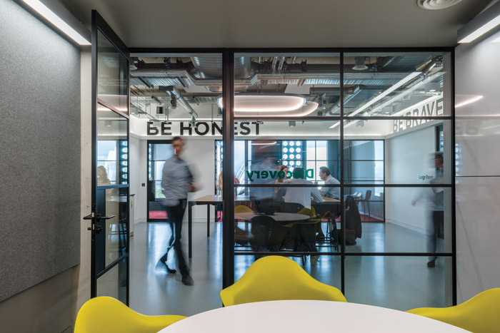 Spark44's motto of Be Bold Be Brave Be Honest wraps around the facia in a meeting room