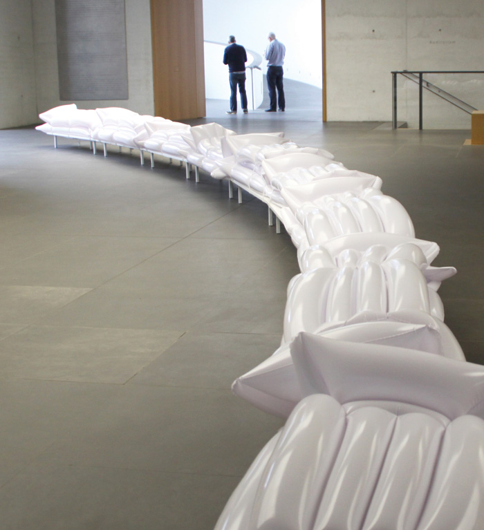 The Line was created for the event Blaue Nacht 2015 at the New Museum in Nuremberg. The 25m-long installation functions somewhere between a large playground and room divider. Some 80 white air mattresses provided visitors with a comfortable place to play, relax, recharge and interact during the event.
