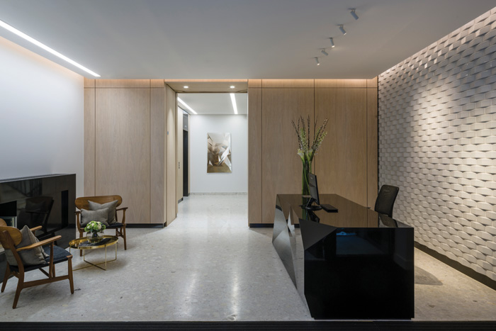 The woven brick appearance of the facade is repeated in the reception area