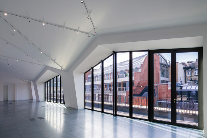 The new folded mansard roof, styled on Bacon's studio, has created a ceiling of sloped planes
