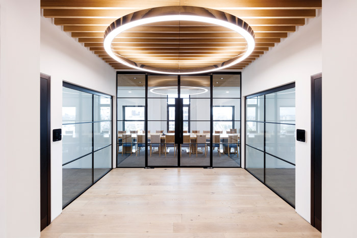 The form of the lighting feature in the entrance to the building is repeated throughout