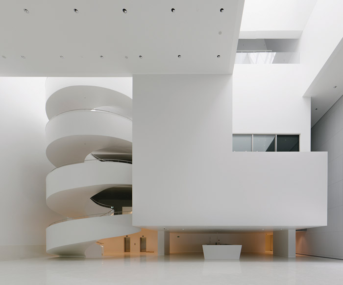 The Philharmonic Hall in Szczecin, Poland, was designed by Barozzi Veiga, with a pure white, minimal four-storey atrium contrasting with an intricate gold interior. The gleaming floor was made using bespoke geometric tiles designed by the architect and manufactured by Huguet. The outside of the 12,734 sq m project was in white-painted concrete, aluminium and glass Client: Mieczyslaw Karlowicz Philharmonic Hall Budget: €30m Architect: Barozzi Veiga assisted by Studio A4 Contractor: Warbud Bespoke flooring and concrete furniture: Huguet