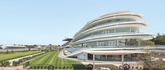 Flemington, home of the Melbourne Cup. Bates Smart designed the five-tiered stand of oval-shaped floors wrapped by viewing balconies. Image Credit: Peter Clarke