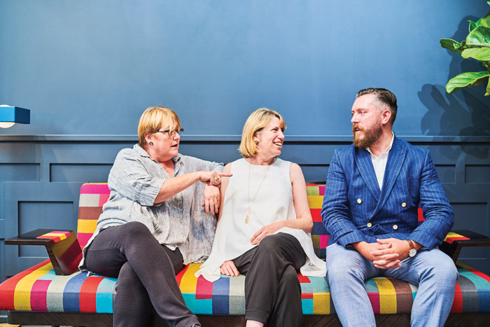 Sarah Ross (centre) tries out a sofa in the London Collection with colleagues