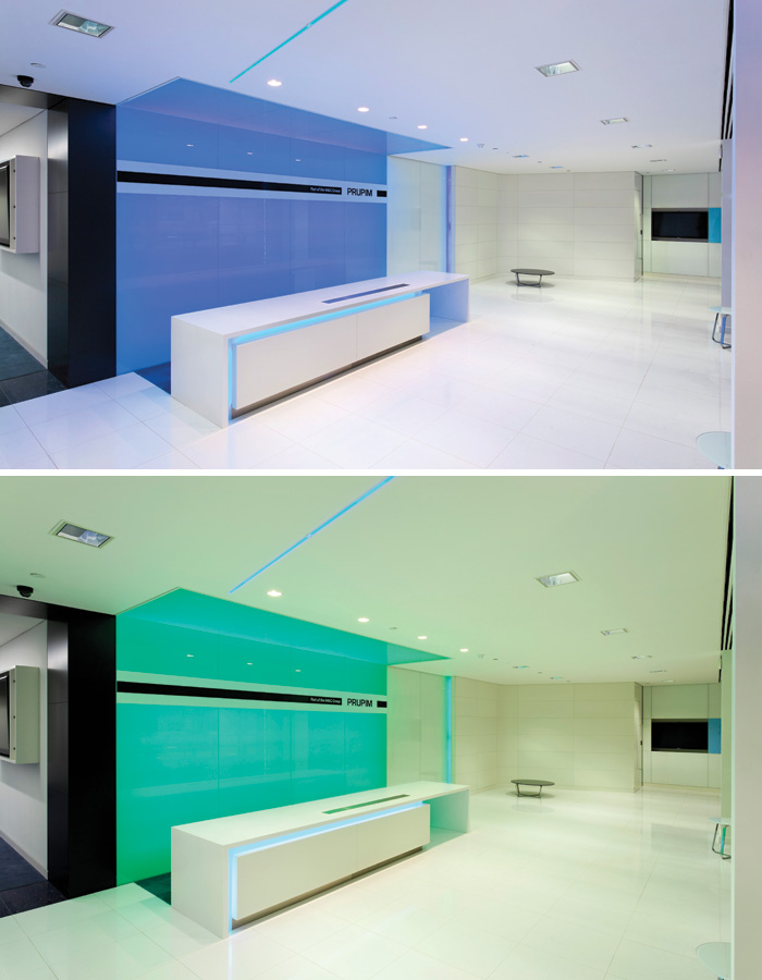 At the London offices of M7G Real Estate, a colour wall sits behind reception, while a thin blue line of light leads into the working environment, acting as both a branding tool and to aid wayfinding