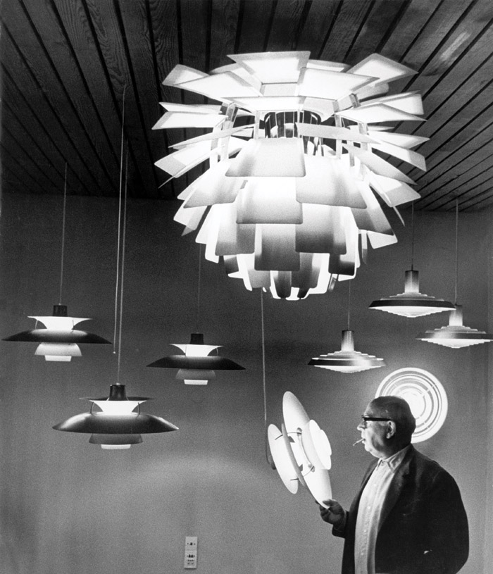 Designer Poul Henningsen with his PH 5s and the PH Artichoke