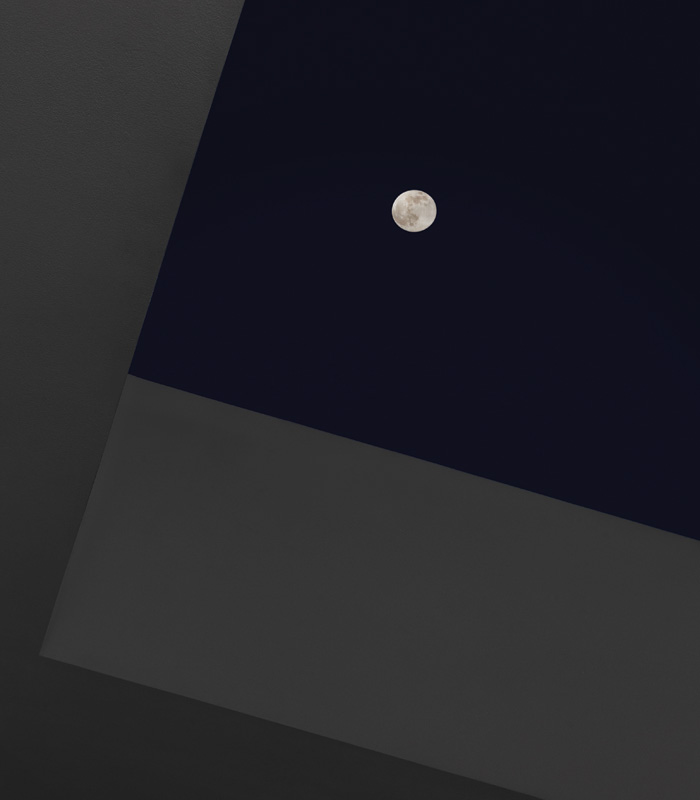 The biggest CoeLux systems have a Switch to Moon mode, rendering the product as a window facing a full moon in a dark sky