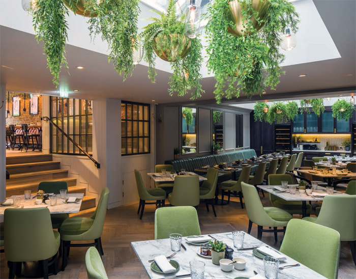 In a former London mews, the Hans Bar and Grill for the 11 Cadogan Gardens hotel was designed by Goddard Littlefair to offer a selection of dining and bar spaces. Image Credit: Gareth Gardner