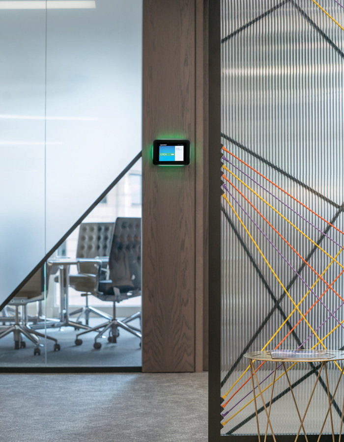 Colourful redundant ethernet cables are worked into a graphic effect on glass partitioning