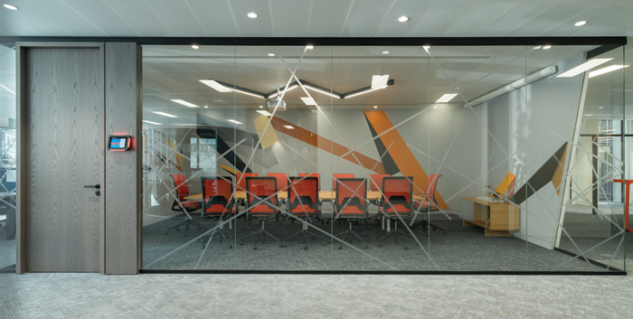 Geometric graphics decorate the glass wall of this larger meeting room