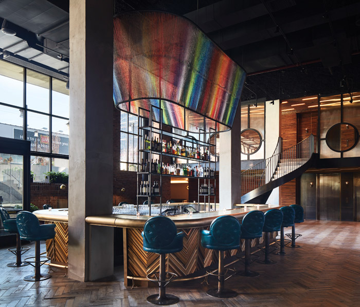 The Williamsburg in New York City has a thriving hotel bar and lounge on the way to check in