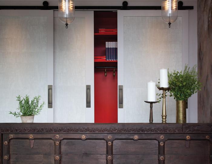 A pop of Kricket's signature orange-red hue is revealed behind sliding doors