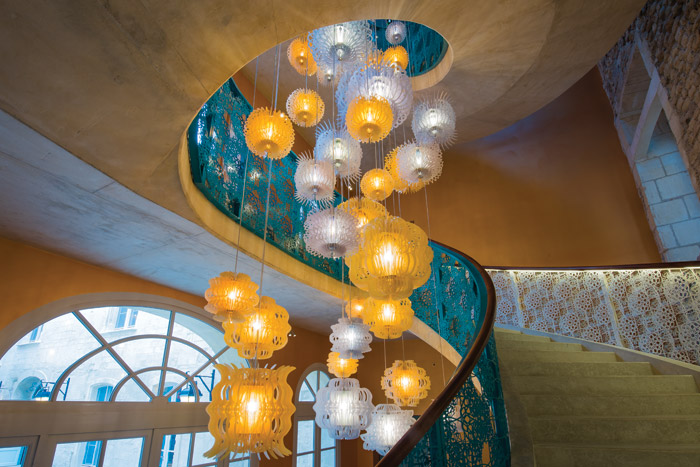 Lights are clustered in the stairwell to dramatic effect. Image Credit: Herve Hote
