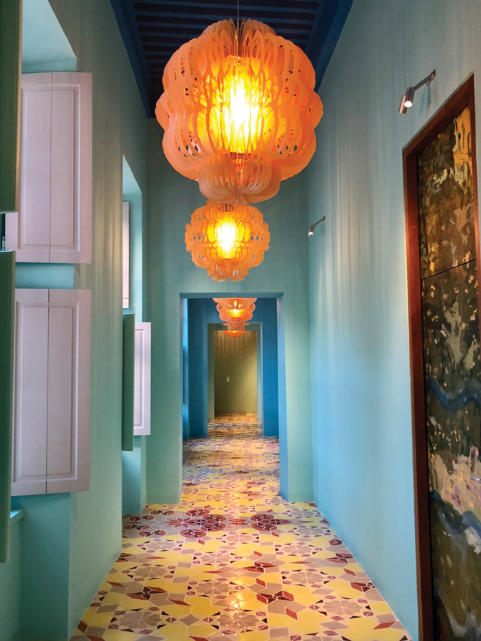 Tiles in a kaleidoscope of colours are featured in this corridor. Image Credit: Pierre Collet