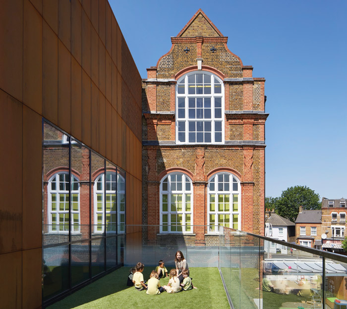 The Bejham School has seen the original Victorian school brought up to 21st-centruy standards, with deep windows revealed and a fake-turf terrace installed