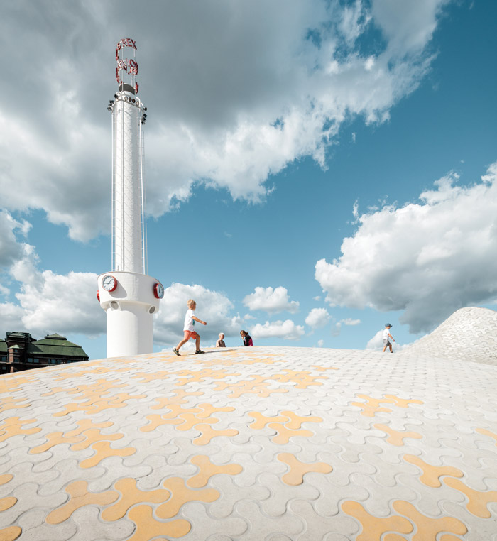 Amos Rex is spelled out in spiralling letters on the 25m-high chimney, re-appropriated to ventilate the museum below. Image Credit: Tuomas Uusheimo