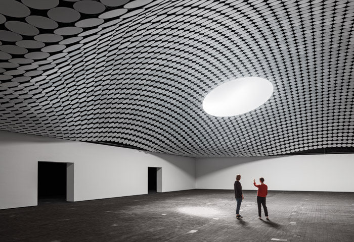 The underside of the domes are covered with fields of perforated aluminium acoustic disks . Image Credit: Tuomas Uusheimo