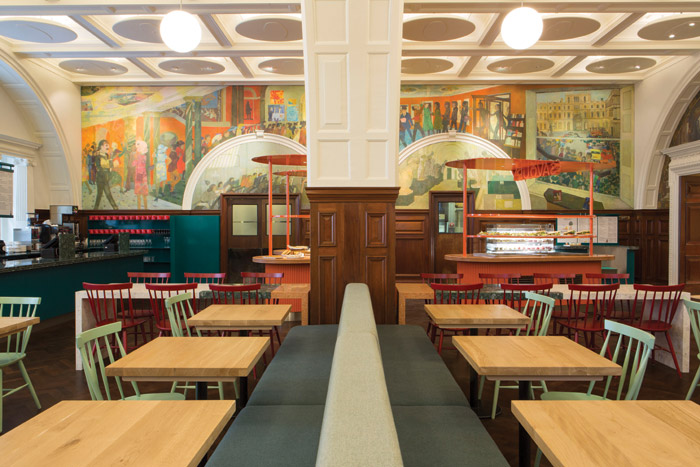 The bright colours of Leonard Rosoman's mural Upstairs Downstairs have inspired the colour palette being utilised in the cafe
