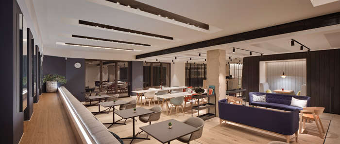 Warm-white light is used to create a calm, welcoming work and social space