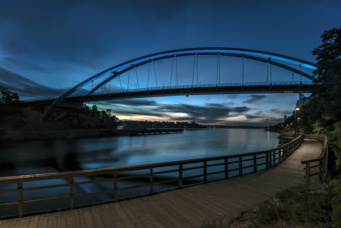 Colours to light the bridge were chosen to harmonise with the sky at dawn (above) and at dusk (left)