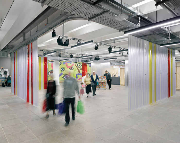 A colourful PVC curtain can be drawn to create a more intimate space in the new internal public square. Image Credit: James Morris