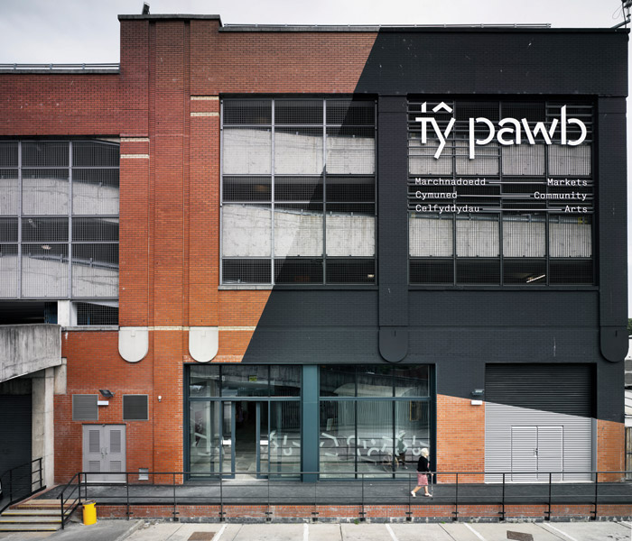 A slice of the facade is painted black, with the name Ty Pawb picked out in silver letters. Image Credit: James Morris