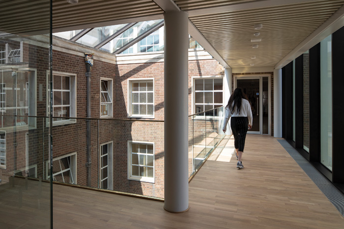 A new five-storey atrium unites the separate parts of the complex