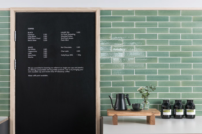 A pale green ceramic tile from the Winchester Collection is used behind the counter